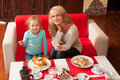 Mother and child in cafe happy family eating restaurant Stock Image