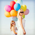 Mother and child with colorful balloons summer holidays celebration family children people concept Stock Photo