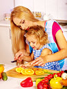 Mother and child cooking at kitchen daughter prepare Royalty Free Stock Photos