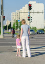 Mother and child crossing the road back view Stock Photo