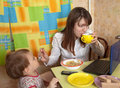 Mother and child eating breakfast Stock Image