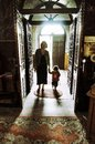 Mother and child entering in a church holding her orthodox Royalty Free Stock Images