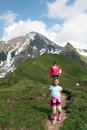 Mother and child family hiking in the alps zillertal austria Stock Photo