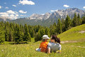 Mother and child family hiking on mountain pasture Stock Photos