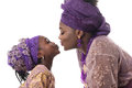 Mother and child girl kissing.African traditional clothing .Isolated Royalty Free Stock Photo
