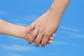 Mother and child holding hands motherhood concept with a women a s hand outdoors on a warm day Stock Photography