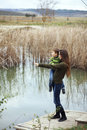 Mother with child outdoor young walking her little son outdoors in autumn Royalty Free Stock Image