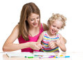 Mother and child paint together happy painting Stock Photos