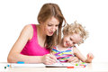 Mother and child paint together painting Stock Photo