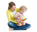 Mother and child play musical toy on white background Royalty Free Stock Photo
