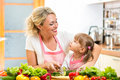 Mother and child preparing healthy food kid Royalty Free Stock Images