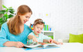 Mother and child reading book at home Royalty Free Stock Photo