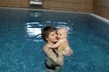 Mother and child resting in pool Stock Photo
