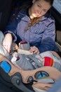 Mother and child in safety seat Stock Images