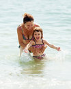 Mother with child in sea happy Royalty Free Stock Image