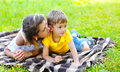 Mother and child son lying on the grass together in summer Royalty Free Stock Photo