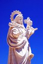 Mother and child statue white marble of a woman against a blue sky garrucha almeria province costa almeria andalusia spain western Royalty Free Stock Photography