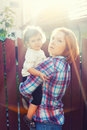 Mother child sun rays and portrait Royalty Free Stock Photography