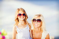 Mother and child in sunglasses summer holidays family children people concept Stock Photos