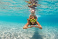Mother with child swim underwater with fun in sea Royalty Free Stock Photo