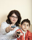 image photo : Mother and child with tv remote controls