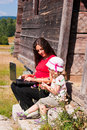 Mother and child using laptop outdoors Stock Images