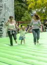 A mother and child walk on inflatable Stonehenge Stock Photo