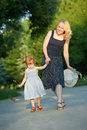 Mother and child walking outdoors Stock Photo
