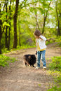 Mother and child walking playing with dog Stock Photo