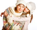Mother with child in winter hats over white background Royalty Free Stock Image