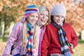 Mother and children on autumn walk Stock Images