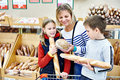Mother and children buying bread in supermarket Stock Images