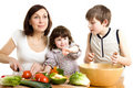 Mother and children cooking at the kitchen Stock Image