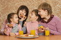 Mother with children eating pizza