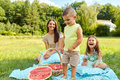 Mother With Children Having Fun In Park. Happy Family Outdoors Royalty Free Stock Photo