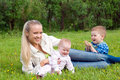 Mother with children on meadow Royalty Free Stock Photo