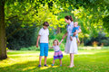 Mother and children in a park Royalty Free Stock Photo