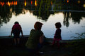 Mother and children in park at night Stock Images