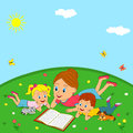 Mother and children are reading book on a meadow Royalty Free Stock Photo
