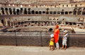Mother and children, standing in Coliseum Stock Photos