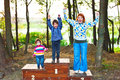 Mother and children winners standing on podium being happy Royalty Free Stock Images