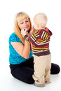 Mother comforting upset child Stock Photos