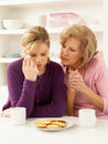 Mother Consoling Grown Up Daughter Royalty Free Stock Photos