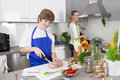 Mother cooking with her son in the kitchen family life meat vegetables Stock Photography