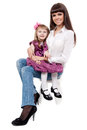 Mother with a cute daughter sitting on a chair Royalty Free Stock Photos