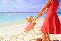 Mother and daugher playing on summer beach Royalty Free Stock Photo