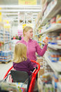 Mother and daughter in baby food section in shop Royalty Free Stock Photo