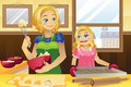 Mother daughter baking cookies Stock Images
