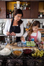 Mother and daughter baking at home Stock Images