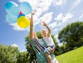 Mother and daughter with balloons in park smiling helium Stock Image